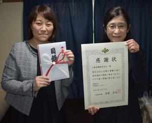 (写真左から、自立援助ホーム アシュレー野田ホーム長、上新電機株式会社 名畑 執行役員 CSR推進室長)